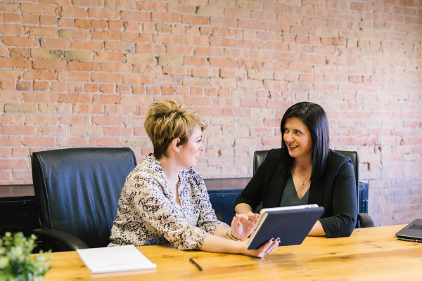 Two women business meeting