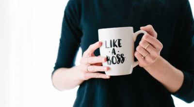 woman holding mug that says like a boss