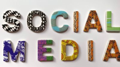 The words social media in assorted colors